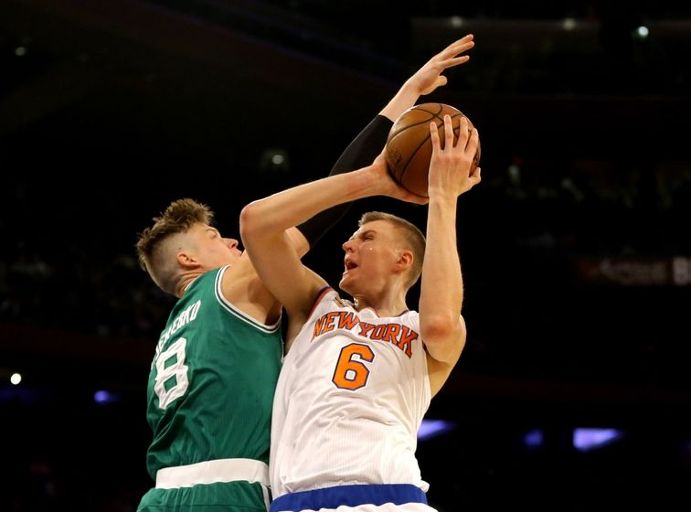 Oct 15, 2016; New York, NY, USA; New York Knicks forward Kristaps Porzingis (6) goes up for a shot against Boston Celtics forward Jonas Jerebko (8) during the first half at Madison Square Garden. The Celtics won 119-107. Mandatory Credit: Andy Marlin-USA TODAY Sports