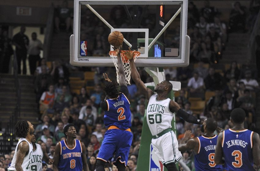 Oct 19, 2016; Boston, MA, USA; New York Knicks forward Maurice Daly Ndour (2) lays the ball past the reach of Boston Celtics forward Ben Bentil (50) during the second half at TD Garden. Mandatory Credit: Bob DeChiara-USA TODAY Sports
