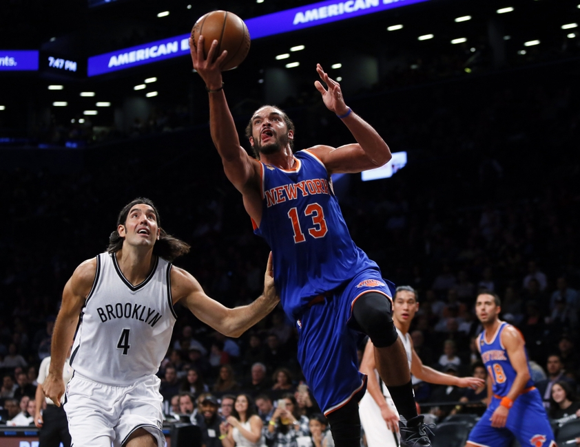 9621497-joakim-noah-luis-scola-nba-preseason-new-york-knicks-brooklyn-nets