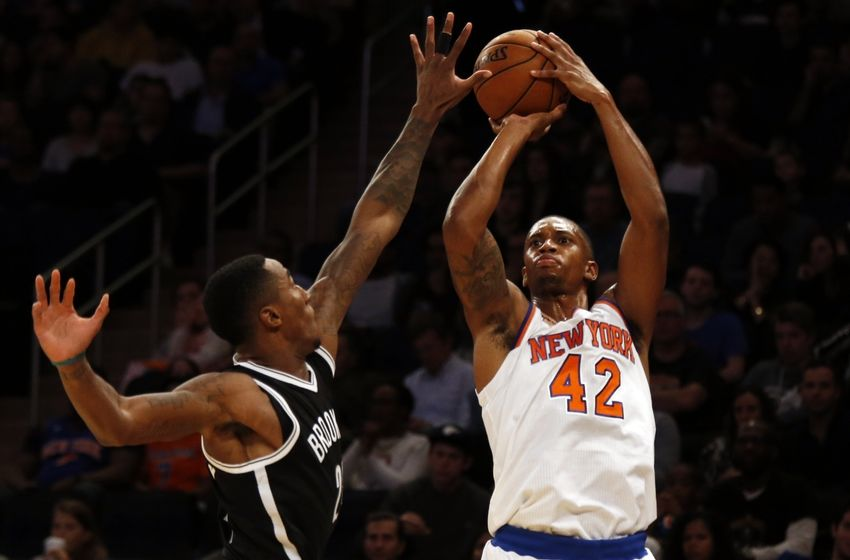 Oct 8, 2016; New York, NY, USA; New York Knicks forward Lance Thomas (42) shoots over Brooklyn Nets guard Rondae Hollis-Jefferson (24) during the first half at Madison Square Garden. Mandatory Credit: Adam Hunger-USA TODAY Sports
