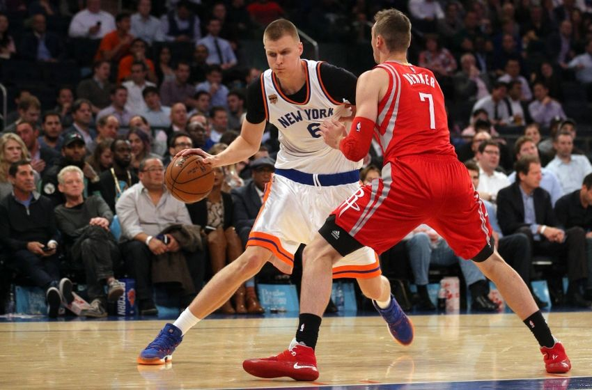 Nov 2, 2016; New York, NY, USA; New York Knicks power forward Kristaps Porzingis (6) controls the ball against Houston Rockets small forward Sam Dekker (7) during the fourth quarter at Madison Square Garden. Mandatory Credit: Brad Penner-USA TODAY Sports