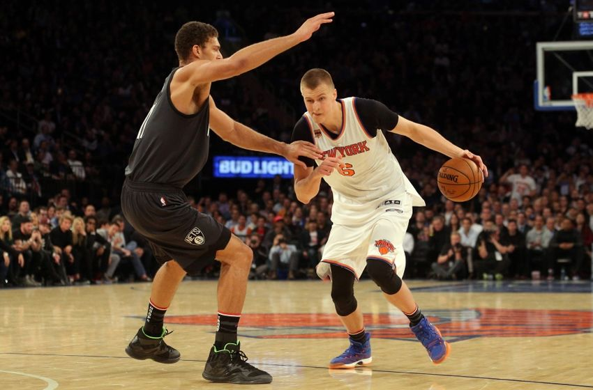 Nov 9, 2016; New York, NY, USA; New York Knicks power forward Kristaps Porzingis (6) drives against Brooklyn Nets center Brook Lopez (11) during the third quarter at Madison Square Garden. Mandatory Credit: Brad Penner-USA TODAY Sports