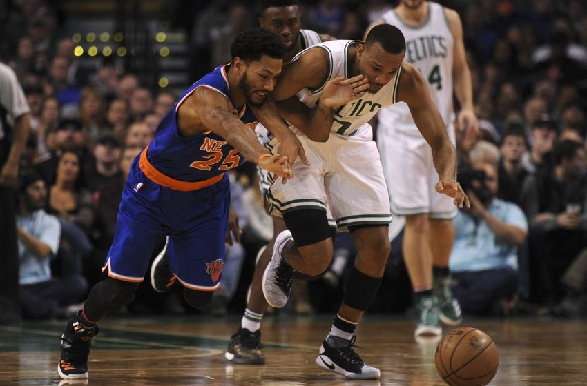 Nov 11, 2016; Boston, MA, USA; New York Knicks guard Derrick Rose (25) and Boston Celtics guard Avery Bradley (0) battle for a loose ball during the second half at TD Garden. Mandatory Credit: Bob DeChiara-USA TODAY Sports