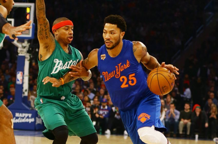 Dec 25, 2016; New York, NY, USA; New York Knicks guard Derrick Rose (25) dribbles the ball while being defended by Boston Celtics guard Isaiah Thomas (4) during the first half at Madison Square Garden. Mandatory Credit: Andy Marlin-USA TODAY Sports