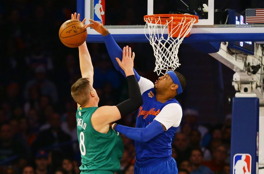 Dec 25, 2016; New York, NY, USA; New York Knicks forward Carmelo Anthony (7) blocks a shot by by Boston Celtics forward Jonas Jerebko (8) during the first half at Madison Square Garden. Mandatory Credit: Andy Marlin-USA TODAY Sports