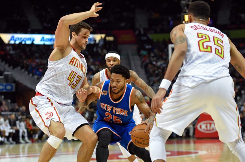 Dec 28, 2016; Atlanta, GA, USA; New York Knicks guard Derrick Rose (25) is defended by Atlanta Hawks forward Kris Humphries (43) during the first half at Philips Arena. Mandatory Credit: Dale Zanine-USA TODAY Sports