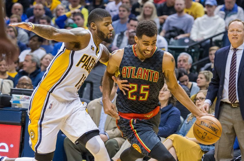 Nov 23, 2016; Indianapolis, IN, USA; Atlanta Hawks forward Thabo Sefolosha (25) dribbles the ball while Indiana Pacers forward Paul George (13) defends in the second half of the game at Bankers Life Fieldhouse. The Atlanta Hawks beat the Indiana Pacers 96-85. Mandatory Credit: Trevor Ruszkowski-USA TODAY Sports