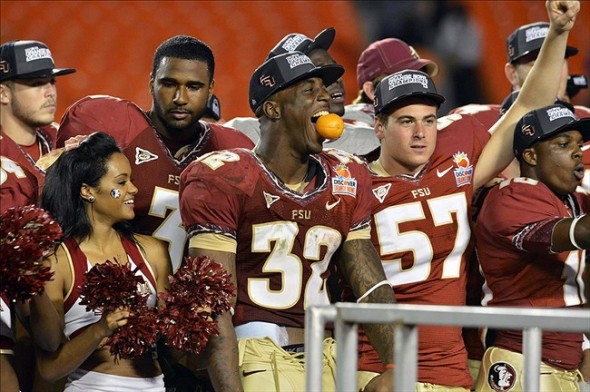 Jan 1, 2013; Miami Gardens, FL, USA; Florida State Seminoles react following the win over the Northern Illinois Huskies at the 2013 Orange Bowl at Sun Life Stadium. The Seminoles defeated the Huskies 31-10. Mandatory Credit: Ron Chenoy-USA TODAY Sports
