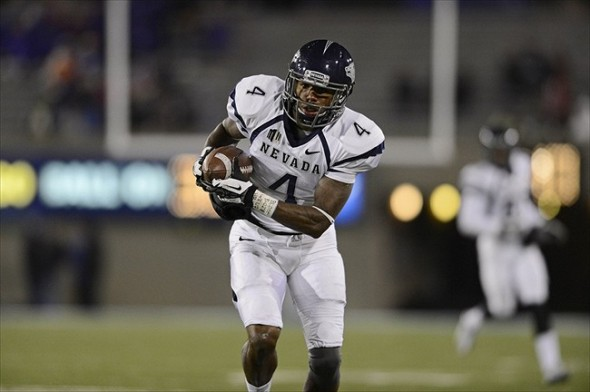 Oct 26, 2012; Colorado Springs, CO, USA; Nevada Wolf Pack wide receiver Brandon Wimberly (4) brings in a reception in the second quarter of the game against the Air Force Falcons at Falcon Stadium. Mandatory Credit: Ron Chenoy-USA TODAY Sports