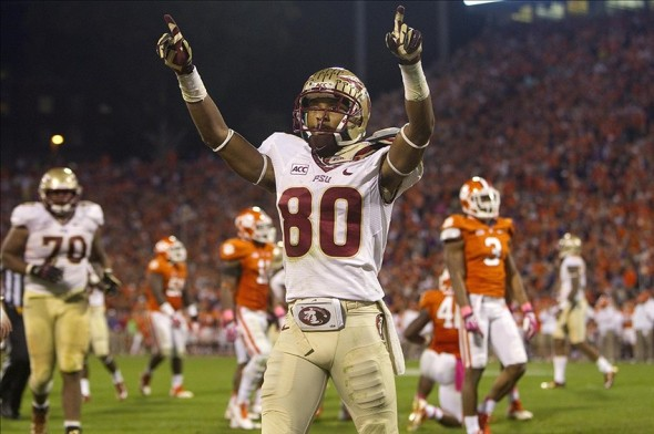 Oct 19, 2013; Clemson, SC, USA; Florida State Seminoles wide receiver Rashad Greene (80) celebrates after scoring a touchdown during the third quarter against the Clemson Tigers at Clemson Memorial Stadium. Mandatory Credit: Joshua S. Kelly-USA TODAY Sports