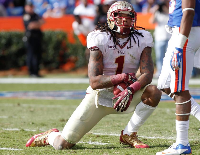 Nov 30, 2013; Gainesville, FL, USA; Florida State Seminoles wide receiver Kelvin Benjamin (1) takes a breath after catching the ball against the Florida Gators during the second half at Ben Hill Griffin Stadium. Florida State Seminoles defeated the Florida Gators 37-7. Mandatory Credit: Kim Klement-USA TODAY Sports