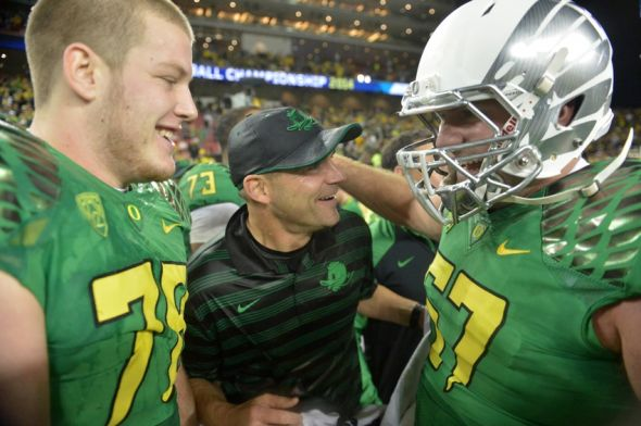 Dec 5, 2014; Santa Clara, CA, USA; Oregon Ducks coach mark Helfrich (C) celebrates with right guard Cameron Hunt (78) and left guard Doug Brenner (57) after their Pac-12 Championship against the Arizona Wildcats at Levi