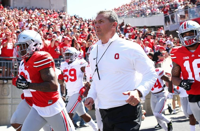 Apr 16, 2016; Columbus, OH, USA; Ohio State head coach Urban Meyer leads the Scarlet and Gray teams onto the field prior to the spring game at Ohio Stadium. Mandatory Credit: Aaron Doster-USA TODAY Sports