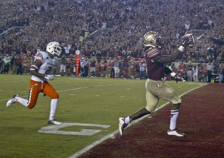 Oct 10, 2015; Tallahassee, FL, USA; Florida State Seminoles running back Dalvin Cook (4) scores his third touchdown, in the fourth quarter of their game against the Miami Hurricanes at Doak Campbell Stadium. The Florida State Seminoles won 29-24. Mandatory Credit: Phil Sears-USA TODAY Sports