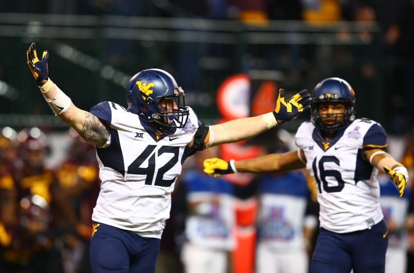 Jan 2, 2016; Phoenix, AZ, USA; West Virginia Mountaineers linebacker Jared Barber (42) and cornerback Terrell Chestnut (16) celebrate after defeating the Arizona State Sun Devils in the Cactus Bowl at Chase Field. Mandatory Credit: Mark J. Rebilas-USA TODAY Sports