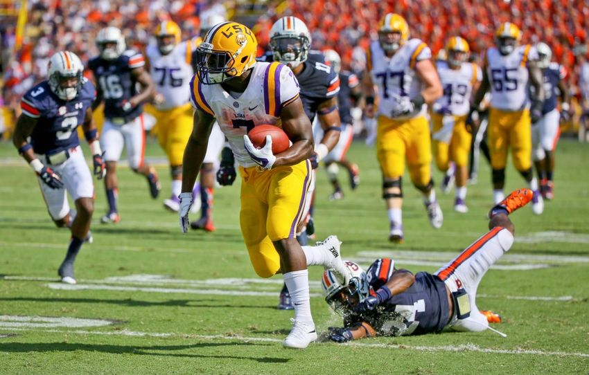 Sep 19, 2015; Baton Rouge, LA, USA; LSU Tigers running back Leonard Fournette (7) breaks away from Auburn Tigers cornerback Ed Paris (24) for a touchdown during the second quarter of a game at Tiger Stadium. Mandatory Credit: Derick E. Hingle-USA TODAY Sports