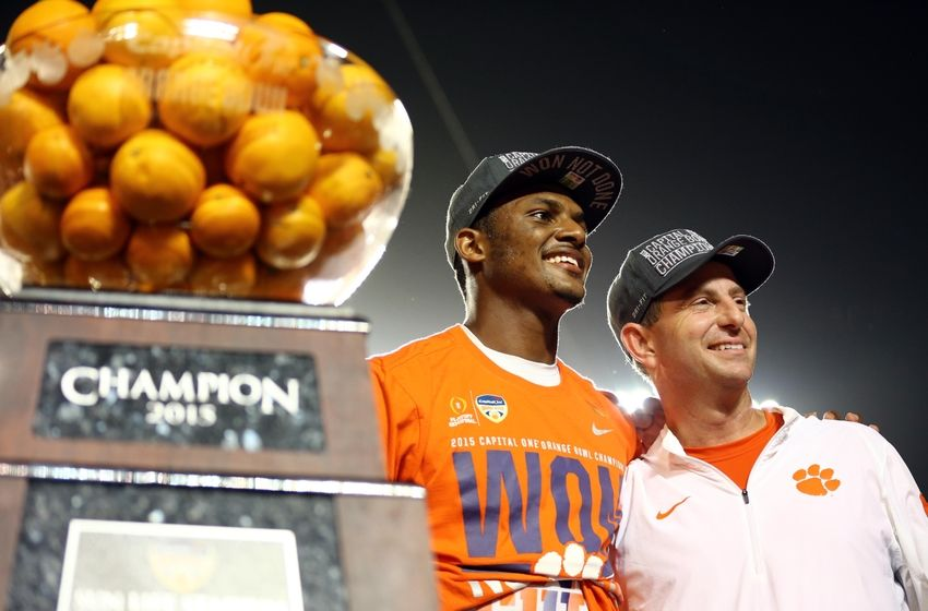Dec 31, 2015; Miami Gardens, FL, USA; Clemson Tigers head coach Dabo Swinney and quarterback Deshaun Watson (4) celebrate after defeating Oklahoma Sooners in the 2015 CFP semifinal at the Orange Bowl at Sun Life Stadium. Clemson won 37-17. Mandatory Credit: Steve Mitchell-USA TODAY Sports