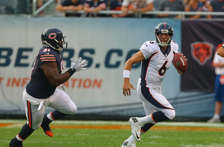 Aug 11, 2016; Chicago, IL, USA; Denver Broncos quarterback Mark Sanchez (6) is pursued by Chicago Bears nose tackle Eddie Goldman (91) during the first quarter at Soldier Field. Mandatory Credit: Dennis Wierzbicki-USA TODAY Sports