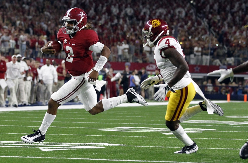 Sep 3, 2016; Arlington, TX, USA; Alabama Crimson Tide quarterback Jalen Hurts (2) runs for a touchdown past USC Trojans defensive back Chris Hawkins (4) during the second half at AT&T Stadium. Mandatory Credit: Tim Heitman-USA TODAY Sports