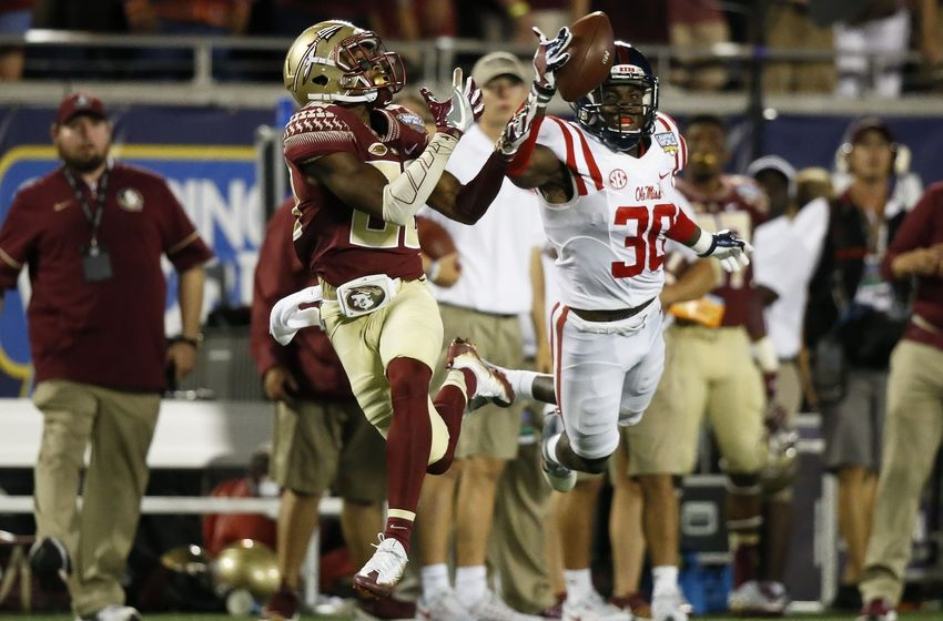 Sep 5, 2016; Orlando, FL, USA; Mississippi Rebels defensive back A.J. Moore (30) knocks the ball down from Florida State Seminoles wide receiver Nyqwan Murray (80) in the third quarter at Camping World Stadium. Florida State Seminoles won 45-34. Mandatory Credit: Logan Bowles-USA TODAY Sports