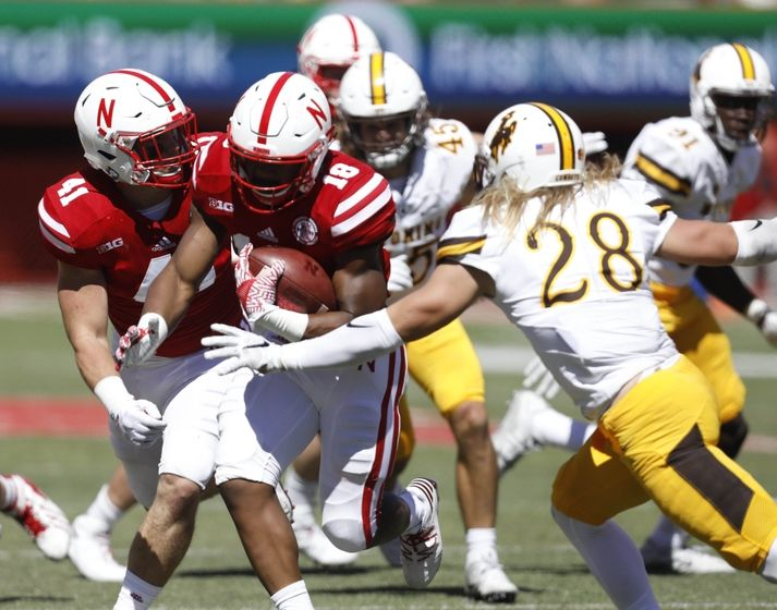 Sep 10, 2016; Lincoln, NE, USA; Nebraska Cornhuskers running back Tre Bryant (18) runs against Wyoming Cowboys free safety Andrew Winged (28) in the second half at Memorial Stadium. Nebraska won 52-17. Mandatory Credit: Bruce Thorson-USA TODAY Sports