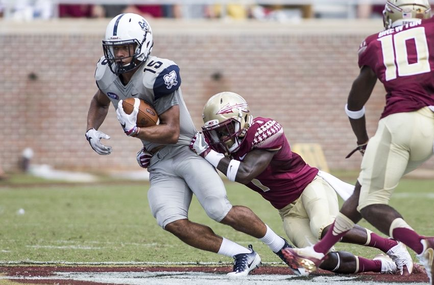 Sep 10, 2016; Tallahassee, FL, USA; Charleston Southern Buccaneers wide receiver Jared Scotland (15) is brought down by Florida State Seminoles defensive back Levonta Taylor (1) during the second half at Doak Campbell Stadium. The Florida State Seminoles defeat the Charleston Southern Buccaneers 52-8. Mandatory Credit: Glenn Beil-USA TODAY Sports