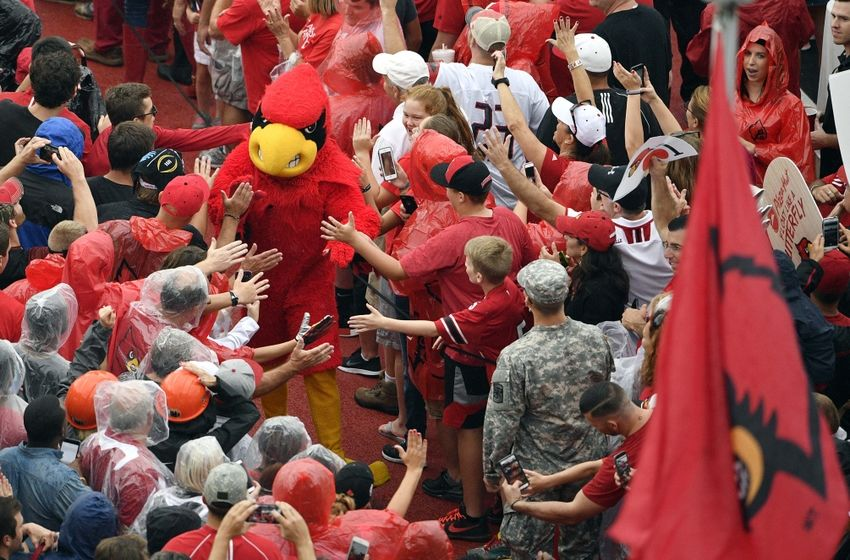 Sep 17, 2016; Louisville, KY, USA; The Louisville Cardinals mascot greets fans during the Card March before facing the Florida State Seminoles at Papa John's Cardinal Stadium. Mandatory Credit: Jamie Rhodes-USA TODAY Sports