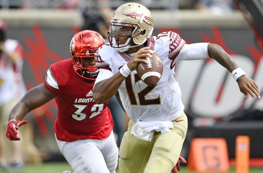 Sep 17, 2016; Louisville, KY, USA; Florida State Seminoles quarterback Deondre Francois (12) scrambles with ball to evade Louisville Cardinals linebacker Stacy Thomas (32) during the second half at Papa John's Cardinal Stadium. Louisville defeated Florida State 63-20. Mandatory Credit: Jamie Rhodes-USA TODAY Sports