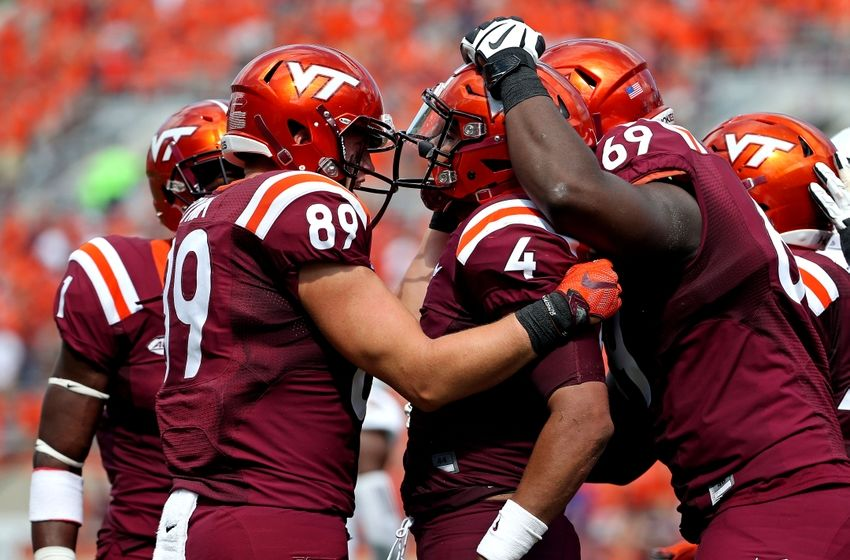 Sep 24, 2016; Blacksburg, VA, USA; Virginia Tech Hokies quarterback Jerod Evans (4) celebrates scoring a touchdown during the third quarter against the East Carolina Pirates at Lane Stadium. Mandatory Credit: Peter Casey-USA TODAY Sports