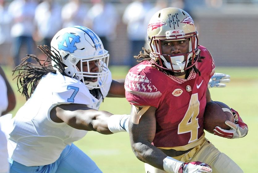 Oct 1, 2016; Tallahassee, FL, USA; Florida State Seminoles running back Dalvin Cook (4) runs the ball past North Carolina Tarheels linebacker Jonathan Smith (7) during the game at Doak Campbell Stadium. Mandatory Credit: Melina Vastola-USA TODAY Sports