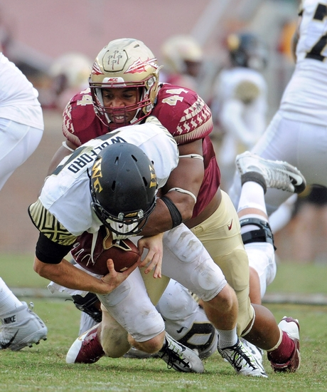Oct 15, 2016; Tallahassee, FL, USA; Florida State Seminoles defensive end Demarcus Walker (44) sacks Wake Forest Demon Deacons quarterback John Wolford (10) during the game at Doak Campbell Stadium. Mandatory Credit: Melina Vastola-USA TODAY Sports