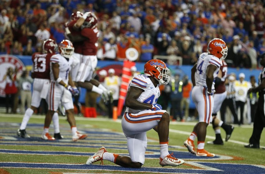 Dec 5, 2015; Atlanta, GA, USA; Florida Gators defensive back Keanu Neal (42) reacts as Alabama Crimson Tide wide receiver Richard Mullaney (16) celebrates a touchdown during the fourth quarter of the 2015 SEC Championship Game at the Georgia Dome. Mandatory Credit: Jason Getz-USA TODAY Sports