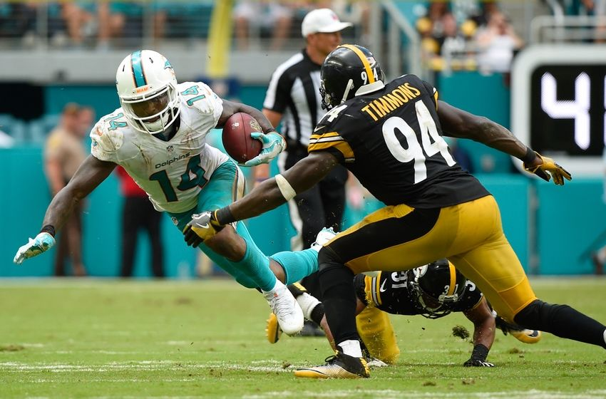 Oct 16, 2016; Miami Gardens, FL, USA; Miami Dolphins wide receiver Jarvis Landry (14) is tackled by Pittsburgh Steelers inside linebacker Lawrence Timmons (94) during the second half at Hard Rock Stadium. The Dolphins won 30-15. Mandatory Credit: Steve Mitchell-USA TODAY Sports
