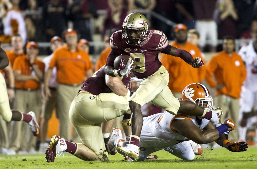 Oct 29, 2016; Tallahassee, FL, USA; Florida State Seminoles wide receiver Kermit Whitfield (8) picks up a first down during the first quarter against the Clemson Tigers at Doak Campbell Stadium. Mandatory Credit: Glenn Beil-USA TODAY Sports