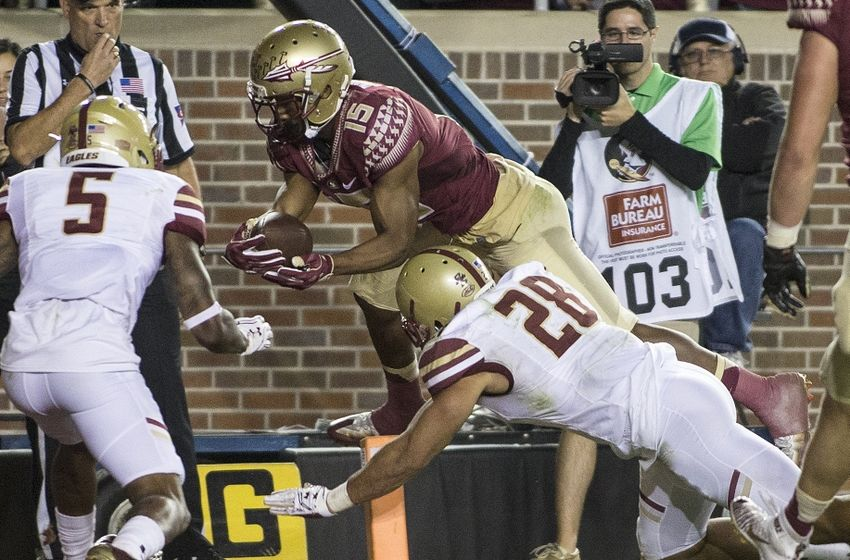 Nov 11, 2016; Tallahassee, FL, USA; Florida State Seminoles wide receiver Travis Rudolph (15) dives for a third quarter touchdown against the Boston College Eagles at Doak Campbell Stadium. Florida State won 45-7. Mandatory Credit: Glenn Beil-USA TODAY Sports
