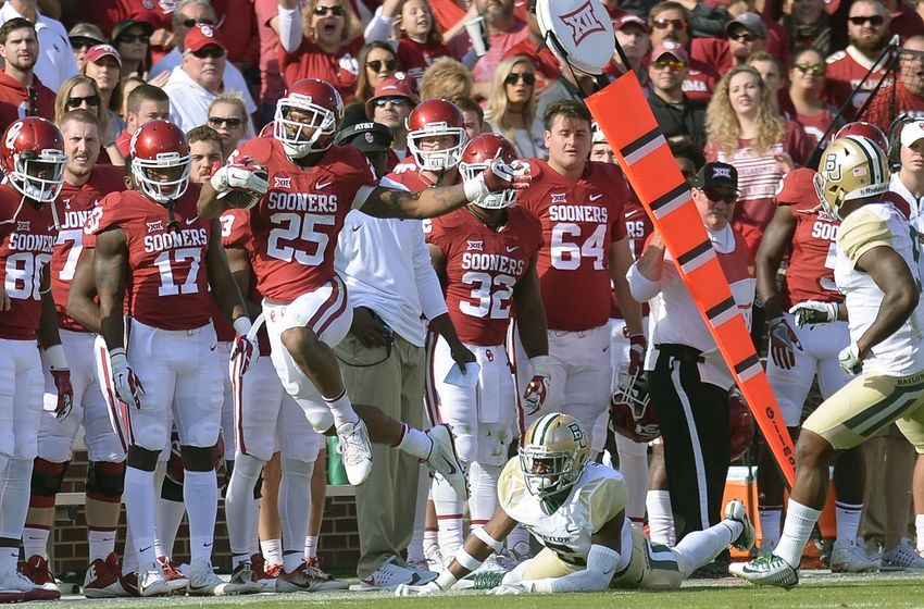 Nov 12, 2016; Norman, OK, USA; Oklahoma Sooners running back Joe Mixon (25) eludes a tackle attempt by Baylor Bears linebacker Thomas Cletcher (5) during the third quarter at Gaylord Family - Oklahoma Memorial Stadium. Mandatory Credit: Mark D. Smith-USA TODAY Sports