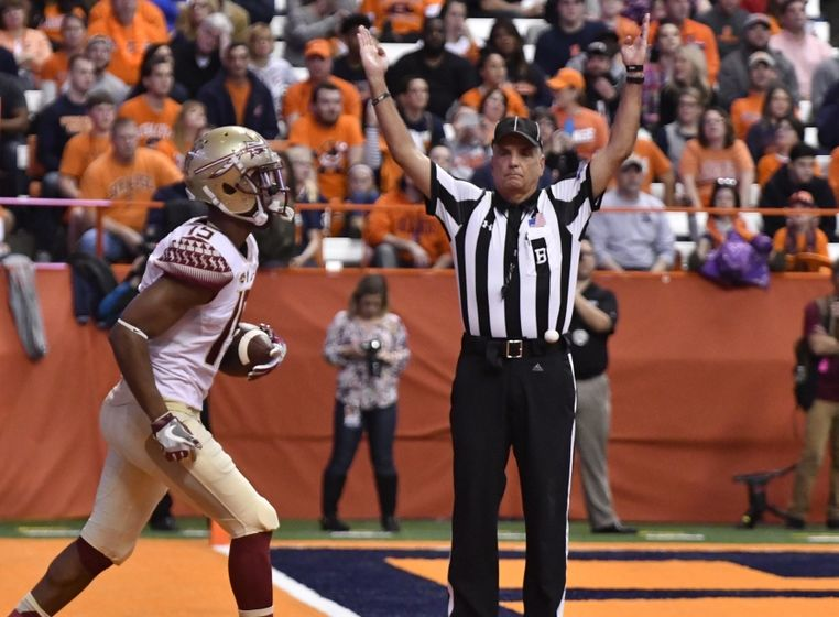Nov 19, 2016; Syracuse, NY, USA; Florida State Seminoles wide receiver Travis Rudolph (15) scores a touchdown during the first quarter of a game against the Syracuse Orange at the Carrier Dome. Mandatory Credit: Mark Konezny-USA TODAY Sports