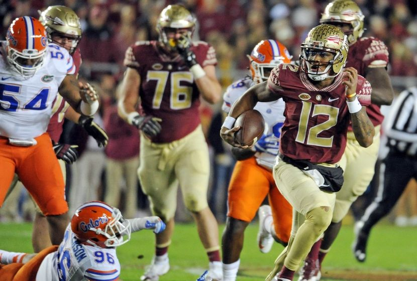 Nov 26, 2016; Tallahassee, FL, USA; Florida State Seminoles quarterback Deondre Francois (12) runs the ball past Florida Gators defensive lineman Cece Jefferson (96) during the first quarter at Doak Campbell Stadium. Mandatory Credit: Melina Vastola-USA TODAY Sports