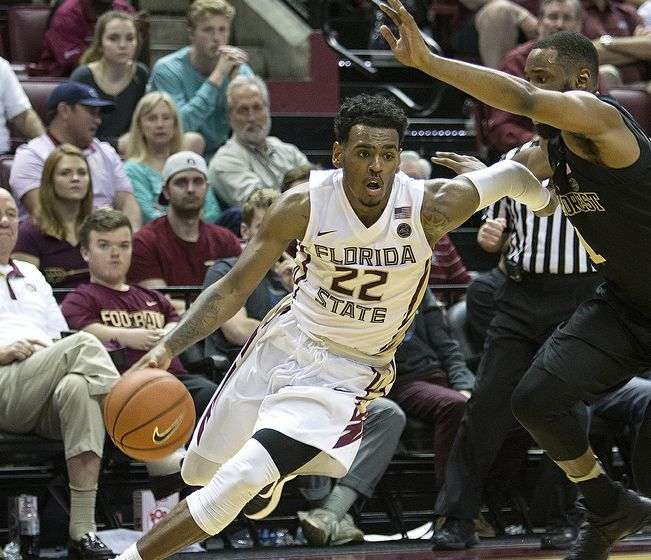 Dec 28, 2016; Tallahassee, FL, USA; Florida State Seminoles guard Xavier Rathan-Mayes (22) to the basket against a Wake Forest Demon Deacon defender at the Donald L. Tucker Center. Florida State won 88-72. Mandatory Credit: Glenn Beil-USA TODAY Sports