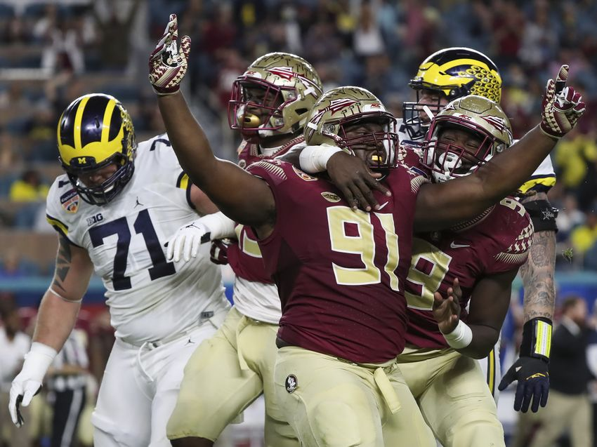 Dec 30, 2016; Miami Gardens, FL, USA; Florida State Seminoles defensive tackle Derrick Nnadi (91) reacts after a sack with defensive end Josh Sweat (9) in the first quarter against the Michigan Wolverines at Hard Rock Stadium. Mandatory Credit: Logan Bowles-USA TODAY Sports