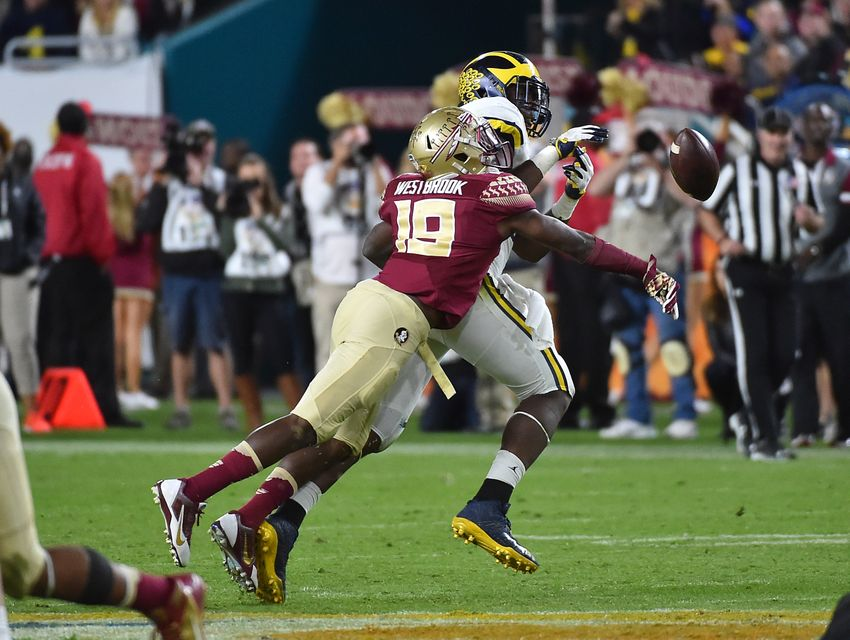 Dec 30, 2016; Miami Gardens, FL, USA;  Florida State Seminoles defensive back A.J. Westbrook (19) breaks up the pass against Michigan Wolverines fullback Henry Poggi (19) during the second half at Hard Rock Stadium. Mandatory Credit: Jasen Vinlove-USA TODAY Sports