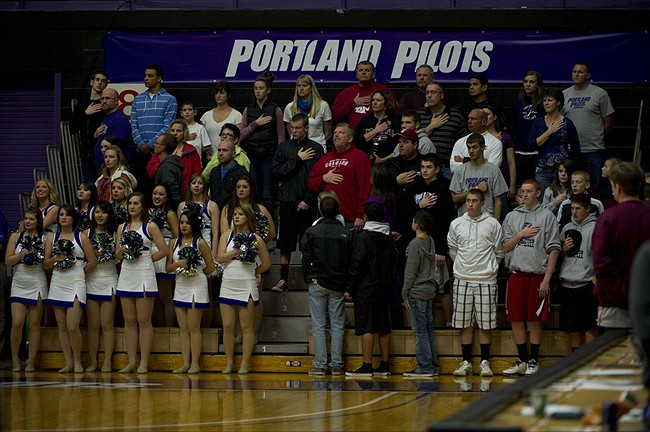 Nov 20; Portland, OR, USA; Portland Pilots fans and cheerleaders stand for the National Anthem before playing the Washington State Cougars at the Chiles Center. Mandatory Credit: Jim Z. Rider