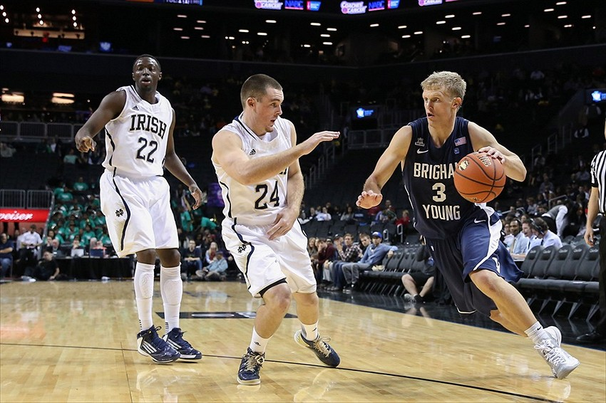 Nov 17, 2012; Brooklyn, NY, USA; Brigham Young Cougars guard Tyler Haws (3) drives past Notre Dame Fighting Irish guard/forward Pat Connaughton (24) during the second half of the consolation game at the Coaches vs Cancer held at Barclays Center. Notre Dame won 78-68. Mandatory Credit: Anthony Gruppuso-USA TODAY Sports