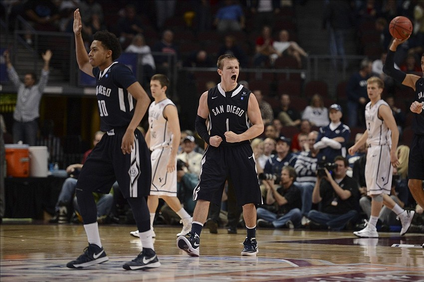 March 8, 2013; Las Vegas, NV, USA; San Diego Toreros guard Christopher Anderson (00) and guard Johnny Dee (1) celebrate against the Brigham Young Cougars during the second half in the quarterfinals of the West Coast Conference tournament at Orleans Arena. Mandatory Credit: Kyle Terada-USA TODAY Sports