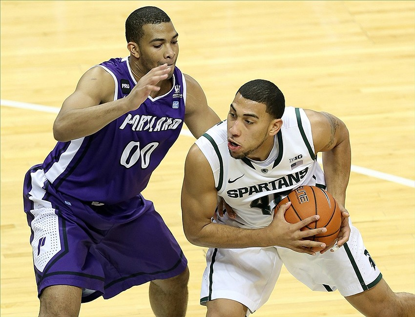 Nov 18, 2013; East Lansing, MI, USA; Michigan State Spartans guard Denzel Valentine (45) dribbles the ball around Portland Pilots guard Kevin Bailey (00) during the second half at Jack Breslin Student Events Center. Michigan State won 82-67. Mandatory Credit: Mike Carter-USA TODAY Sports