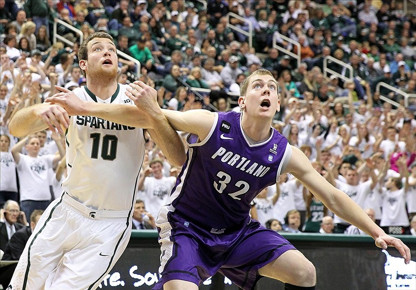 Nov 18, 2013; East Lansing, MI, USA; Michigan State Spartans forward Matt Costello (10) and Portland Pilots forward Ryan Nicholas (32) battle for position during the second half of a game at Jack Breslin Student Events Center. Michigan State won 82-67. Mandatory Credit: Mike Carter-USA TODAY Sports