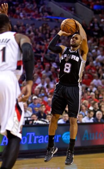 May 12, 2014; Portland, OR, USA; San Antonio Spurs guard Patty Mills (8) shoots against the Portland Trail Blazers during the first quarter in game four of the second round of the 2014 NBA Playoffs at the Moda Center. Mandatory Credit: Craig Mitchelldyer-USA TODAY Sports