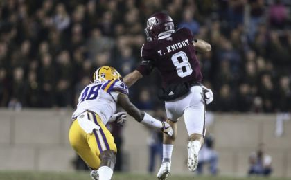 Nov 24, 2016; College Station, TX, USA; Texas A&M football Aggies quarterback Trevor Knight (8) runs with the ball as LSU Tigers linebacker Donnie Alexander (48) attempts to make a tackle during the fourth quarter at Kyle Field. Mandatory Credit: Troy Taormina-USA TODAY Sports