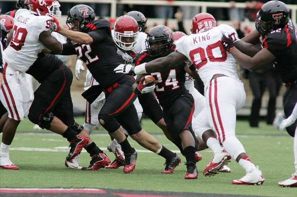 Oct 6, 2012; Lubbock, TX, USA; Texas Tech Red Raiders running back Eric Stephens Jr. (24) is pursed by Oklahoma Sooners left end David King (90) in the first half at Jones AT