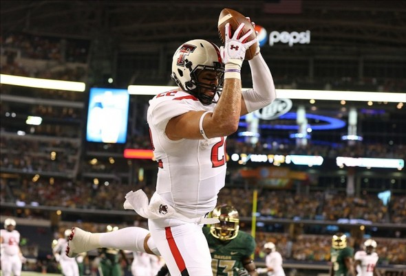 Nov 16, 2013; Arlington, TX, USA; Texas Tech Red Raiders tight end Jace Amaro (22) catches a touchdown pass in the first quarter against the Baylor Bears at AT